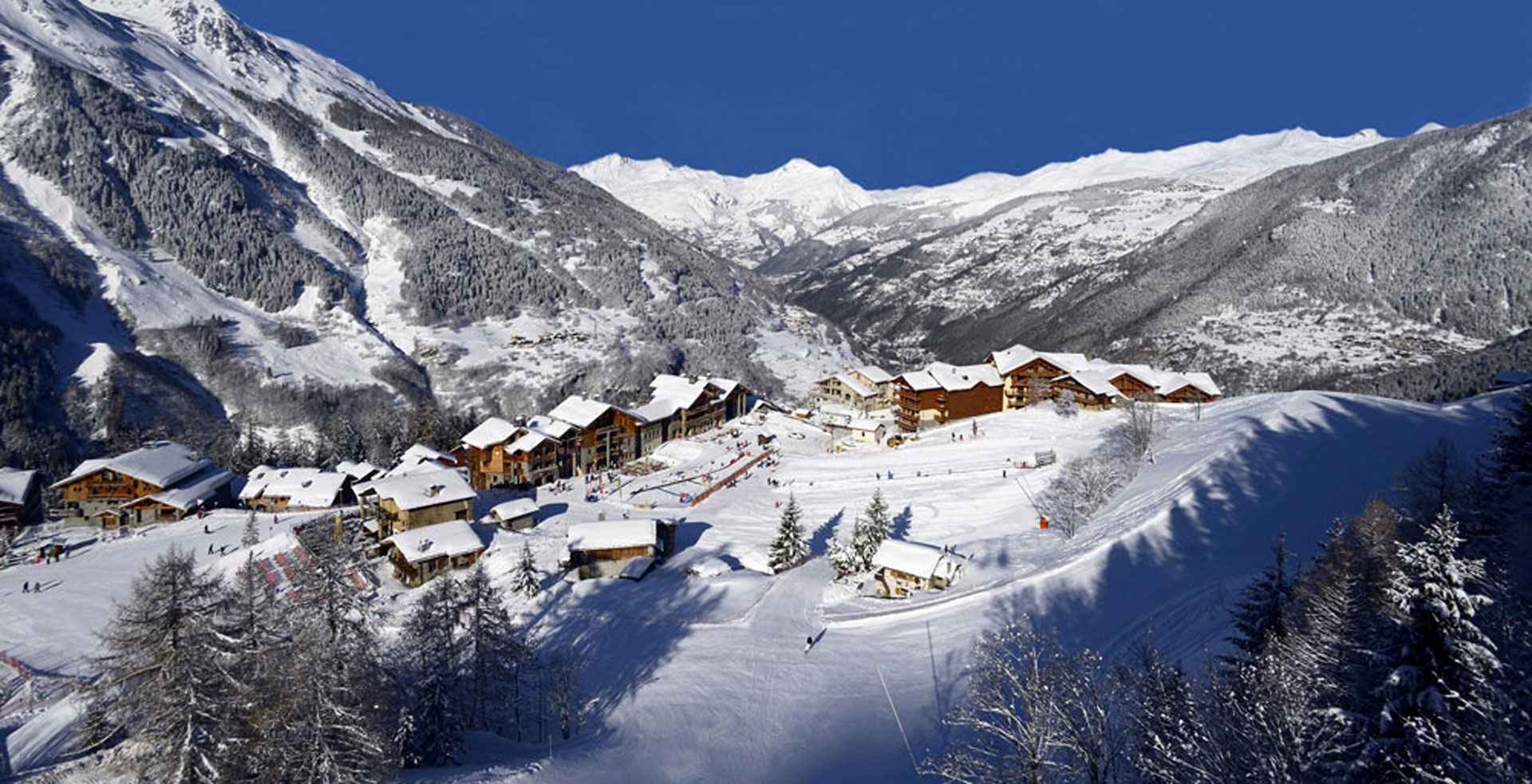 The snowfront of Sainte Foy where beginners and children's ski lessons take place as seen from a drone