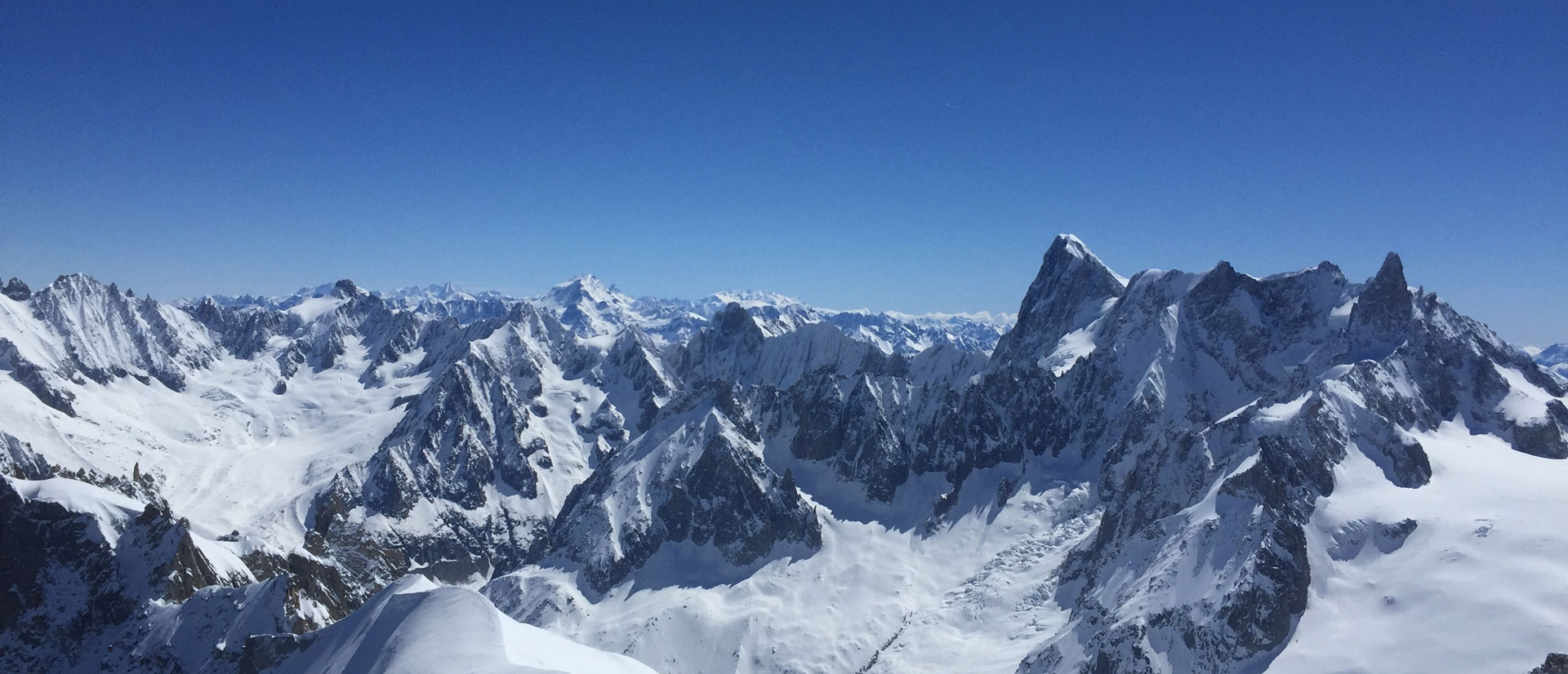 The majestic 4000m high mountains in the Chamonix area juxtaposed with a bright blue ski - perfect for off-piste skiing