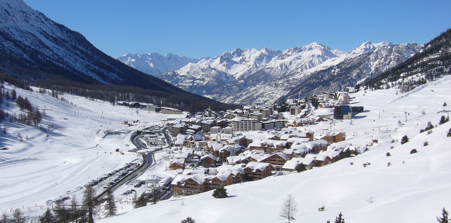 Snow covered chalets in the village of Montgenevre, surrounded by mountains and ski slopes