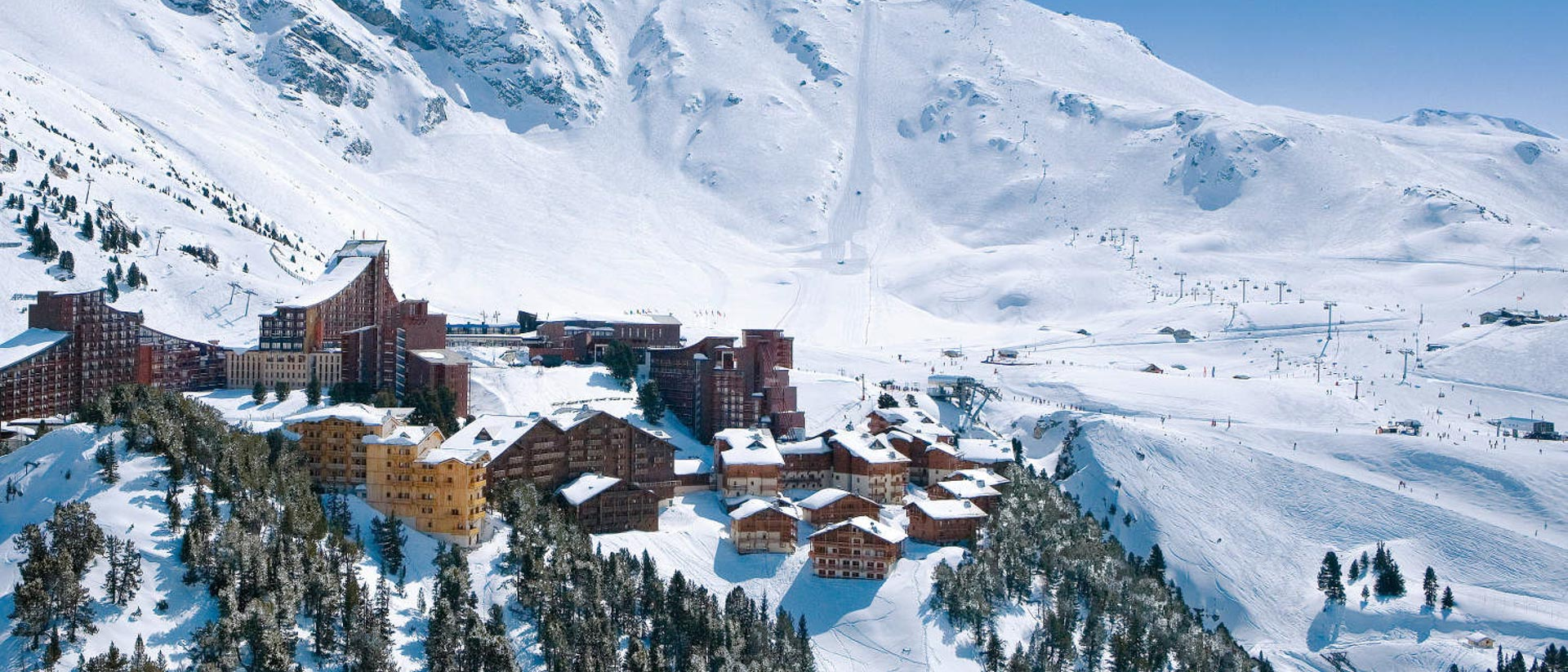 The village of Les Arcs overlooking the ski runs and chairlifts on the mountains