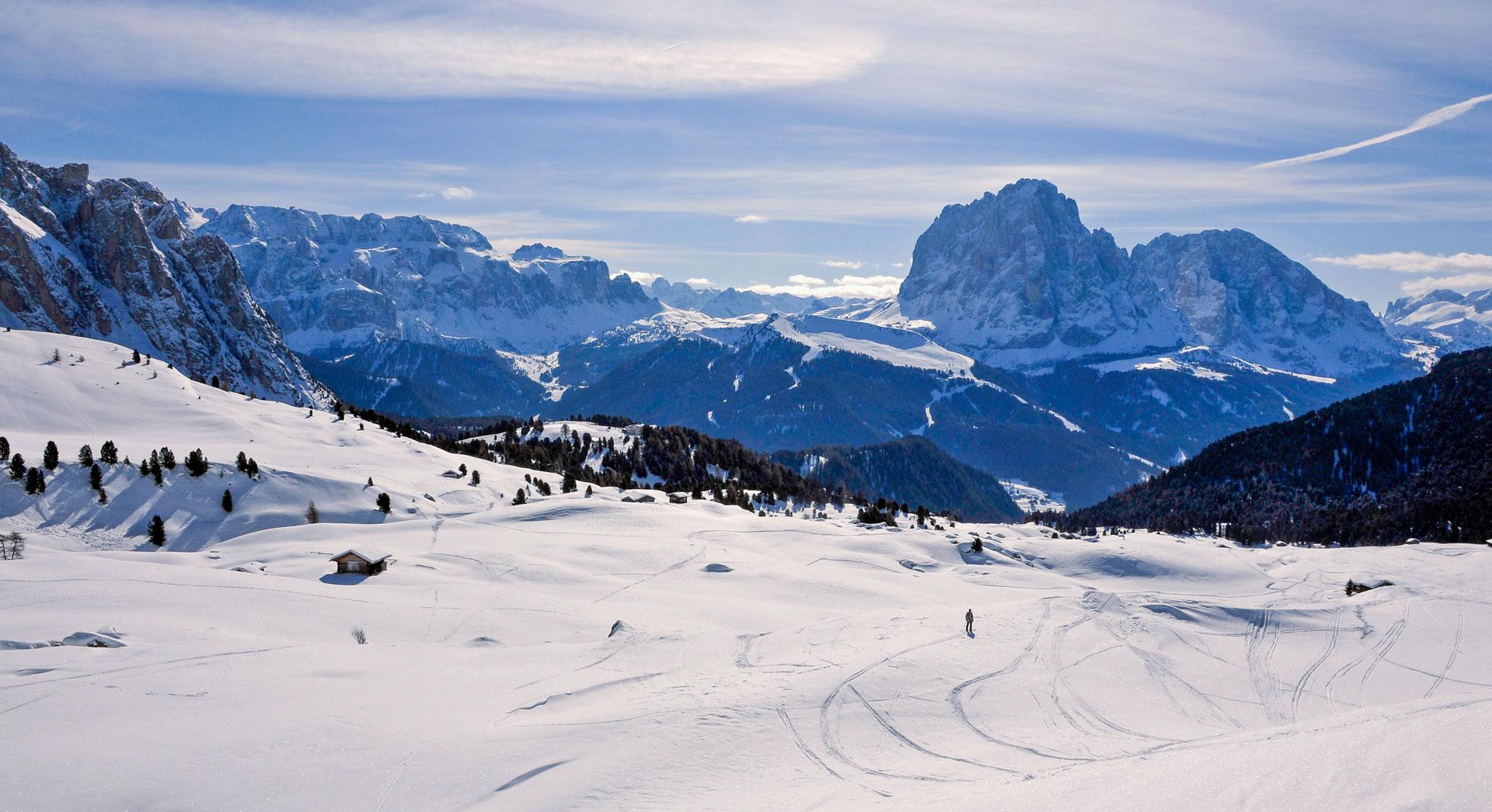 Single skier enjoying an off-piste beginner lesson in the mountains of Val Gardena